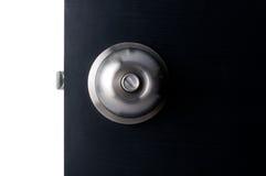 Aluminium door handle. Aluminium door knob on the black door white background Stock Image