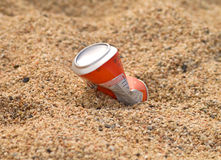 Aluminium drink container in sand Royalty Free Stock Image