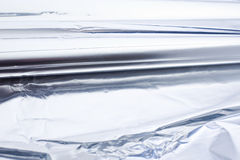 Aluminium foil roll. As a closeup. Smooth Structure. tin foil Royalty Free Stock Images