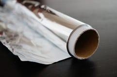 Aluminium foil. Rolled aluminium foil stock photo