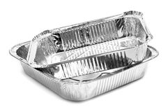Aluminium foil trays. Some aluminium foil trays on a white background Royalty Free Stock Photography