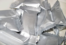 Aluminium foil wrappers. Blank small aluminium foil wrappers Royalty Free Stock Photos