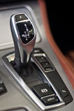 Aluminium gear stick. With control panel in a luxury car Stock Photography