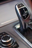 Aluminium gear stick with i-drive. And control panel in a luxury car Royalty Free Stock Photo