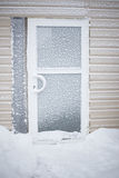 Aluminium glass door covered with snow Royalty Free Stock Photography