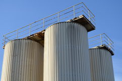 Aluminium grain silos with work platform Royalty Free Stock Photo