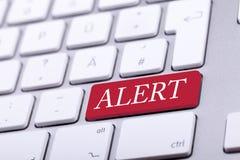 Aluminium keyboard with alert word on it Stock Photo
