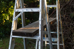 Aluminium ladders and scaffold plank. DIY aluminium ladders and timber scaffolding plank for home use Royalty Free Stock Images