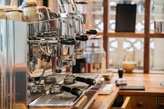 Aluminium large coffee maker two grinders in wooden bar royalty free stock photography