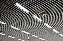 Aluminium Meshed Ceiling. With rows of fluorescent lights Royalty Free Stock Photography