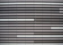 Aluminium metal facade cladding texture, with the colors white, light gray and dark gray Royalty Free Stock Photo