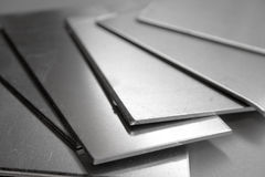 Aluminium plates. Roughly cut stock photos