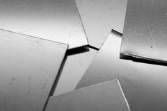 Aluminium plates. Roughly cut stock image