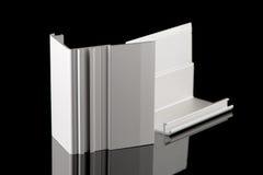 Aluminium profile sample. Isolated on black background stock photography
