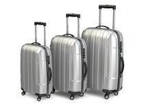 _ Aluminium resväskor på vit bakgrund Arkivbilder