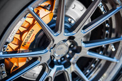 Aluminium rim. Aluminum wheel of a Nissan GTR caliper Royalty Free Stock Photography