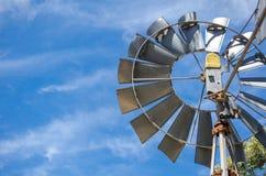 Aluminium silver circle wind turbine with blue sky in a background. A Aluminium silver circle wind turbine with blue sky in a background stock photos