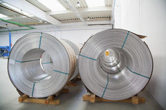 Aluminium spools. Aluminium wire spools in wire stretching factory Stock Photos