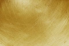 Aluminium texture background with gold gradient, pattern of scratches on stainless steel.  stock images
