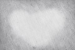 Aluminium texture background, scratches on stainless steel with heart shaped symbol for valentines day in vintage style.  royalty free stock photo