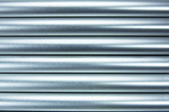 Aluminium tubes background Royalty Free Stock Photo