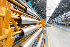 Aluminium tubes are on special racks. Aluminium tubes are on special yellow racks Royalty Free Stock Photography