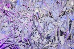 Aluminiumfolie met multi-colored verlichting Achtergrond en textuur van aluminiumfolie stock foto