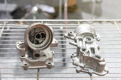 Aluminum alloy exhaust body or engine part of automobile vehicle or Lawn mower before machining made from high pressure die stock image