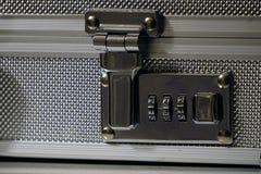 Aluminum attache case lock close up view. Aluminum attache case lock close up royalty free stock photography