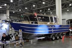 Aluminum boat Weldcraft Cuddy King 900 EX for 10 International b. MOSCOW - MARCH 09, 2017: Aluminum boat Weldcraft Cuddy King 900 EX for 10 International boat Royalty Free Stock Photography