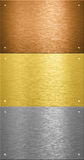 Aluminum and brass metal plates with rivets Royalty Free Stock Photo