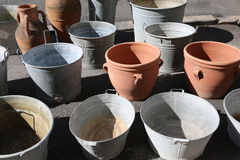 Aluminum buckets and clay pots for sale at the market Royalty Free Stock Image
