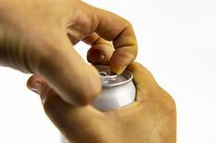 Aluminum can for drinks in the hands of man stock photo