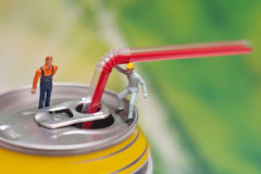 Aluminum can with the ring pull and straw. Teamwork concept Stock Images