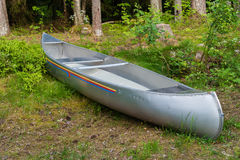 An aluminum canoe in a forest Stock Image