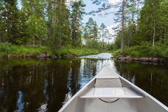 An aluminum canoe near whitewater. In a forest Stock Photo