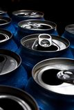 Aluminum Cans. Numerous aluminum soda pop cans over black, open stock photography