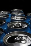 Aluminum Cans. Numerous aluminum soda pop cans over black, open stock images