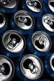 Aluminum Cans. Numerous aluminum soda pop cans over black, open royalty free stock photography