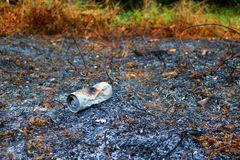 Aluminum cans burned by the fire. Stock Photo