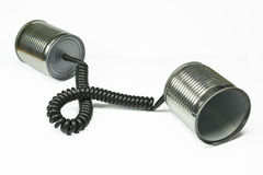 Aluminum cans. Two aluminum cans connected through a telephone cord , concept for communication Royalty Free Stock Photos