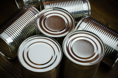 Aluminum cans on wooden background Royalty Free Stock Image