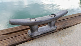 Aluminum cleat on dock at Ao Po Grand Marina Royalty Free Stock Photos