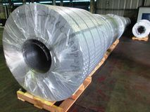Aluminum coil packed. Slip  with transparent plastic and mounted stowage pine base Stock Images