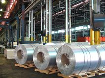Aluminum coils, Rolled aluminium coil. Rolled aluminum coils located in storage section, then move to the packaging section Stock Image