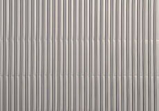 Aluminum corrugated metal wall. Unpainted aluminum grey corrugated goffered metal wall texture Royalty Free Stock Photos