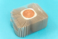 Aluminum cpu cooler heat sink  on blue. Background Royalty Free Stock Photos