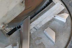 Aluminum cutting machines are in use. Aluminum cutting machines are in use work Royalty Free Stock Photos