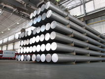 Aluminum cylinders. Stored an industrial plant, such cylinders are employed to produce profiles through the extrusion process Royalty Free Stock Photo