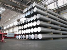 Aluminum cylinders. Stored an industrial plant, such cylinders are employed to produce profiles through the extrusion process Stock Image